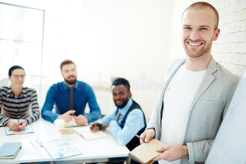 Young businessman leading meeting royalty free stock photos