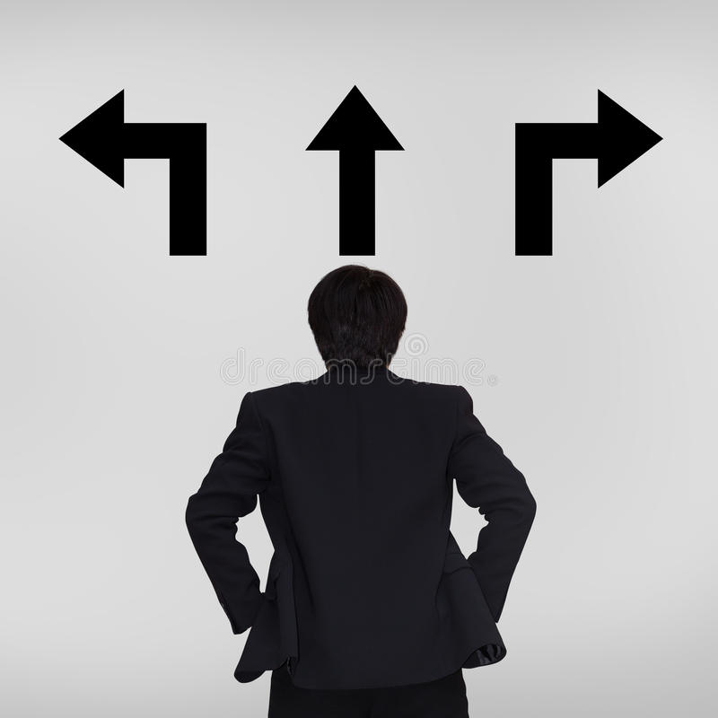 Download Young Businessman Looking At Arrows Stock Image - Image: 27686619