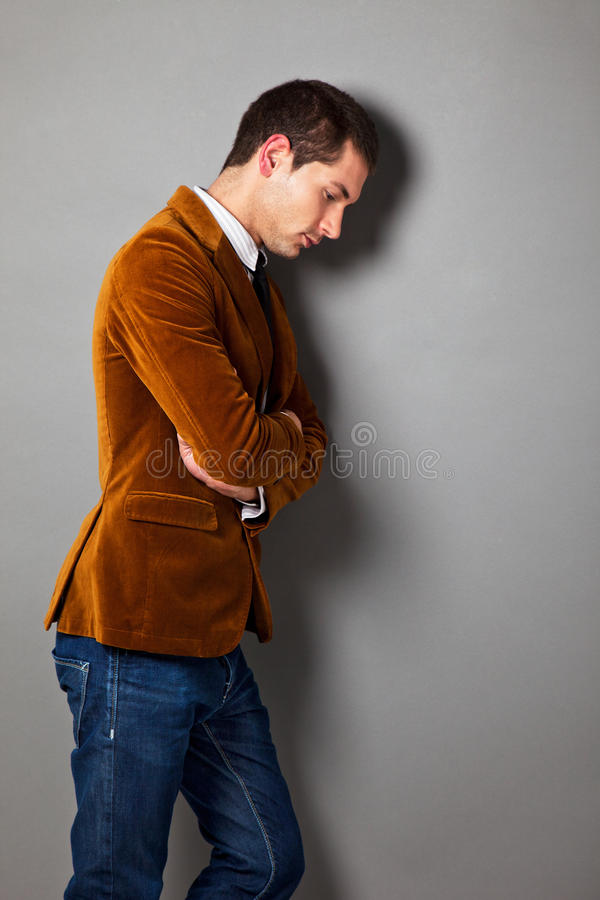 Young businessman looking down royalty free stock photography