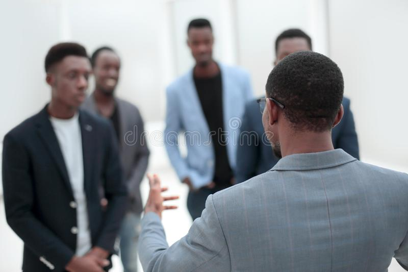 Young businessman looking at his business team royalty free stock photo