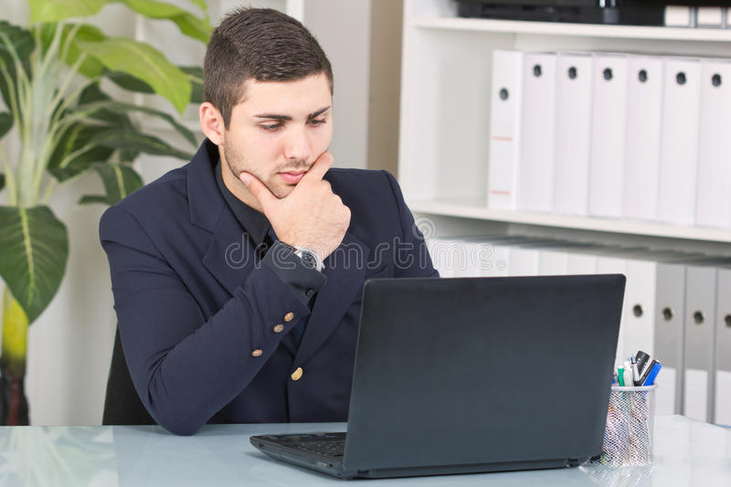 Young Businessman Looking At The Laptop Royalty Free Stock Photos
