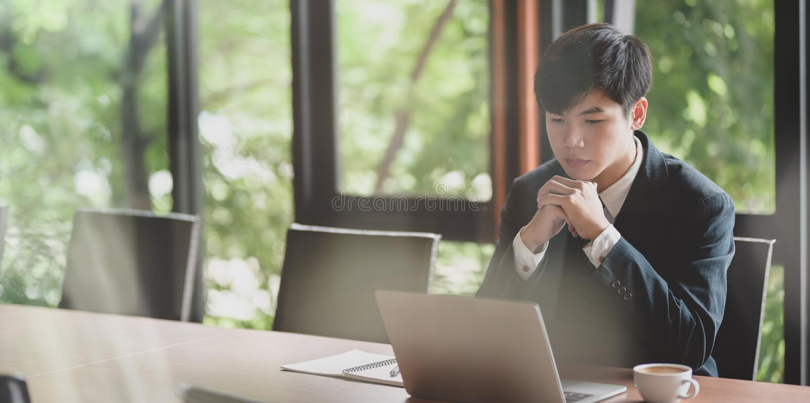 Young businessman looking stressful while working on project royalty free stock images