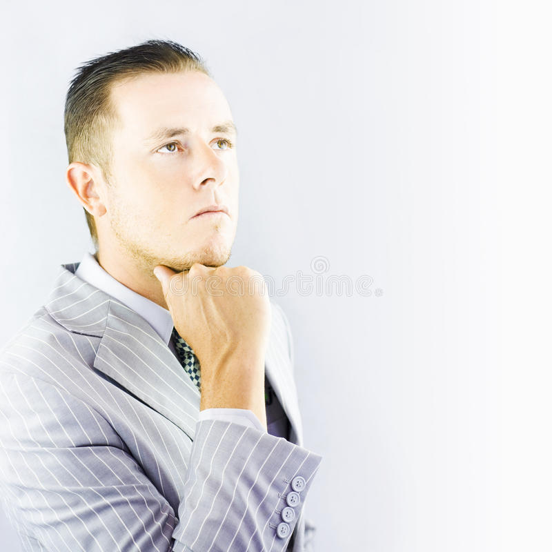 Young businessman looking thoughtful