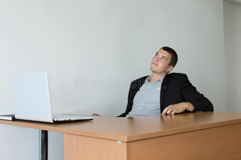 Young Businessman Looking Up While Thinking stock images