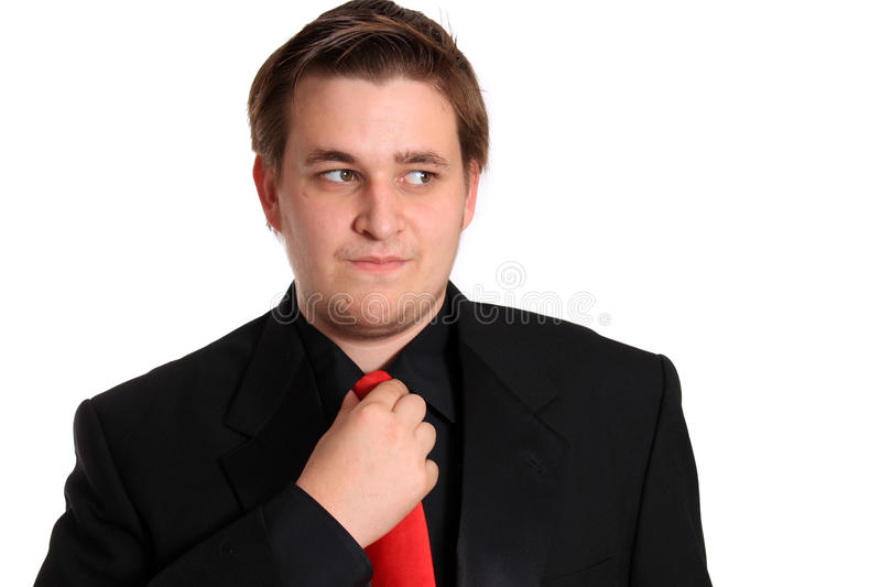 Young Businessman Loosening Tie Royalty Free Stock Image