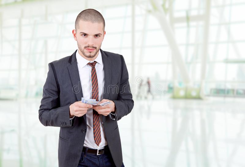 Money. Young businessman with money, at the office royalty free stock photo