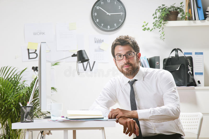 Download Young Businessman In Office Looking At Camera. Stock Photo - Image: 32773048