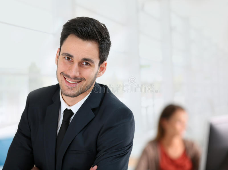 Young businessman at office. Portrait of young businessman in office royalty free stock images