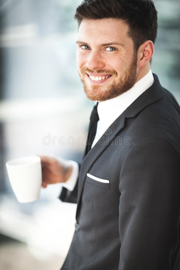 Young businessman in office royalty free stock photography
