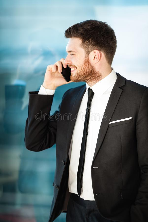 Young businessman in office stock image