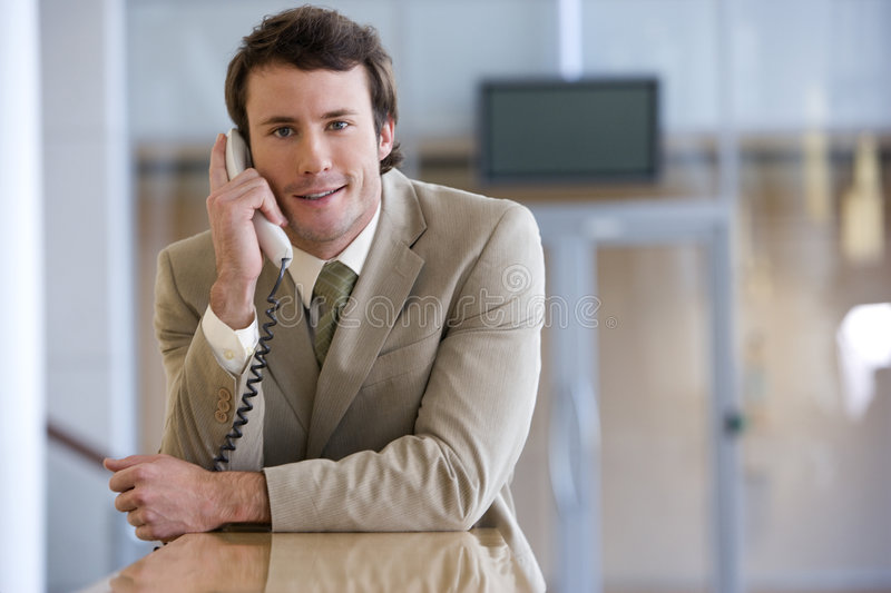 Young businessman on phone royalty free stock images