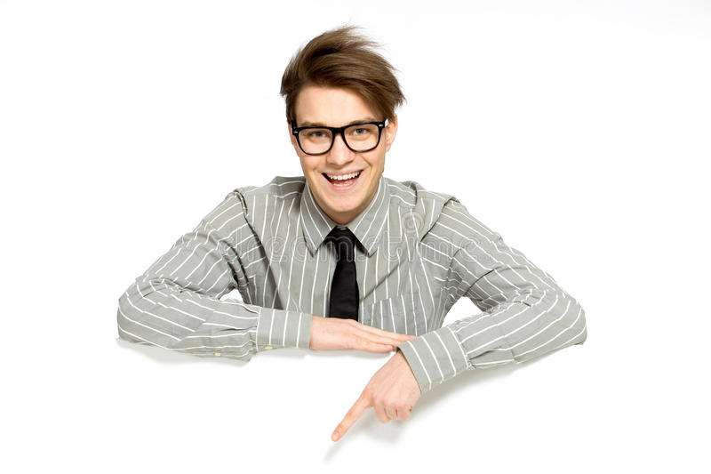 Young businessman pointing stock photo