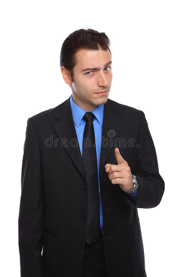 Young businessman pointing with attitude stock photography
