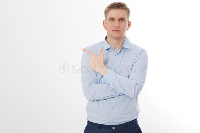 Young businessman pointing on copy space isolated on white background. Business success ceo concept. Man crossed arms. Guy leader stock photos