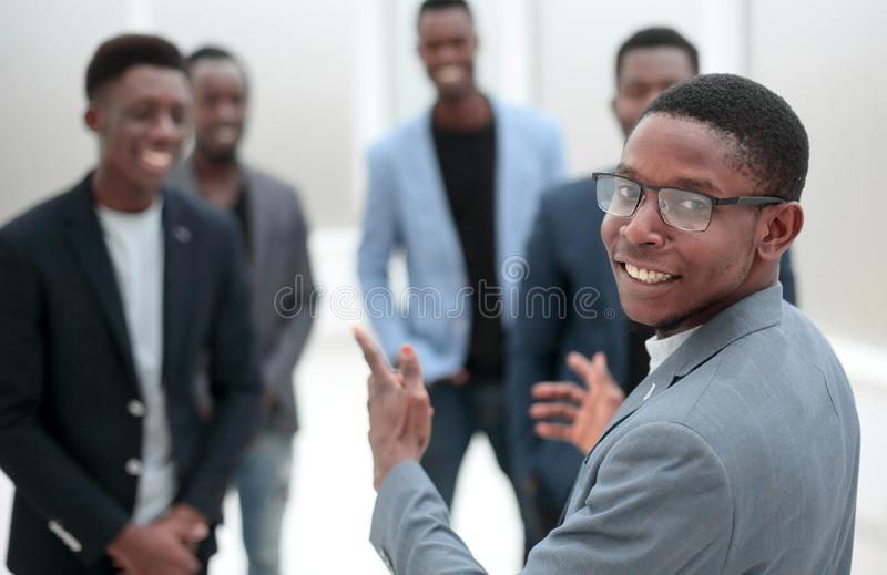 Young businessman pointing to his business team stock images
