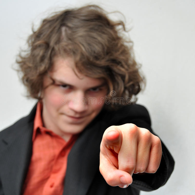Young businessman points his finger at you stock photo