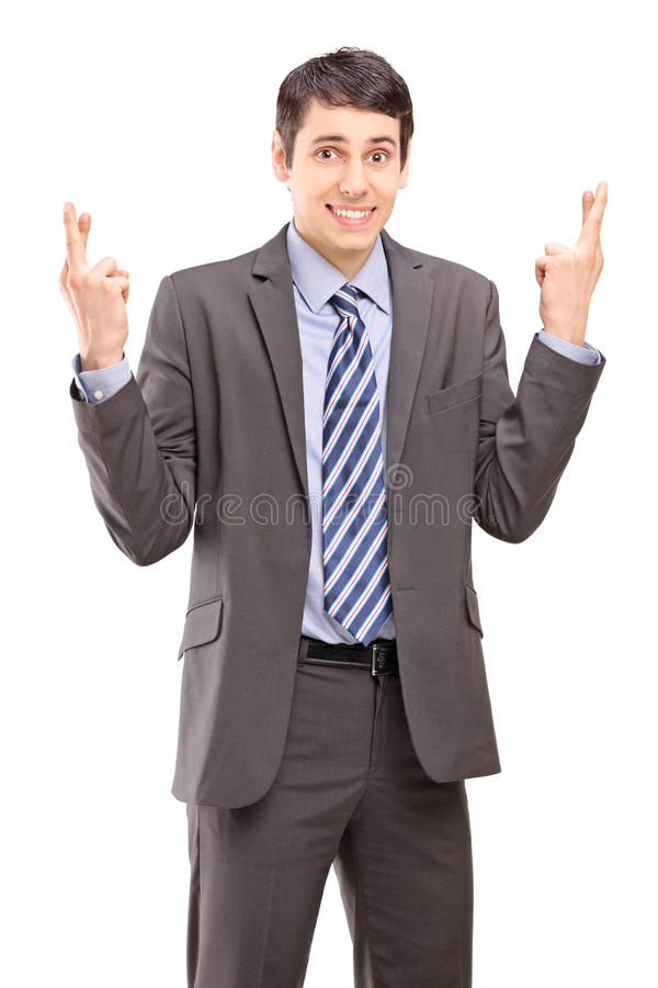 Download Young Businessman Posing With Fingers Crossed For Luck Stock Photos - Image: 29907773