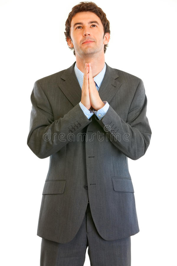 Download Young Businessman Praying For Success Stock Photo - Image: 19696644