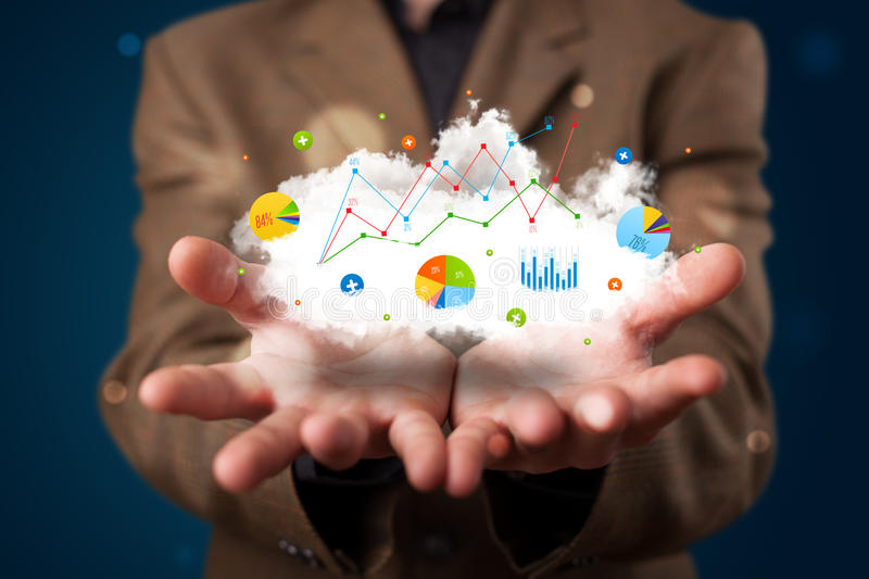 Young businessman presenting cloud with charts and graph icons a stock photography