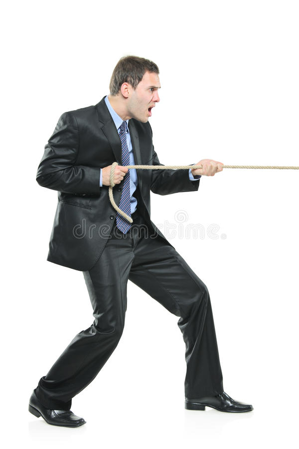 Download A Young Businessman Pulling A Rope Stock Image - Image: 12150371