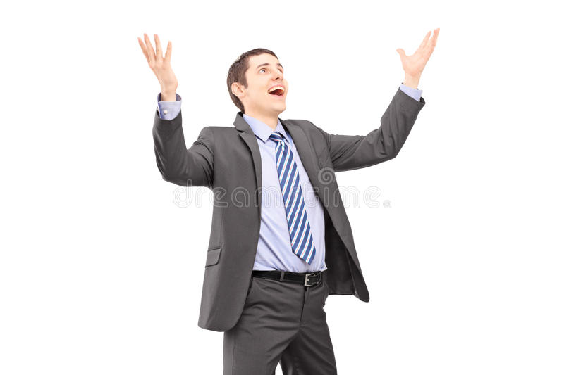 Download Young Businessman With Raised Hands Waiting Something To Fall Stock Photo - Image: 30623860