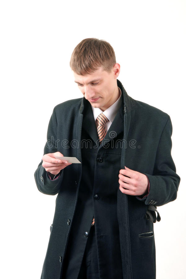 Young businessman reading a card