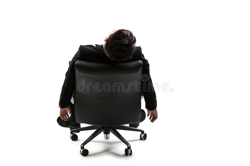 Young businessman resting on chair. Isolated over white royalty free stock photos