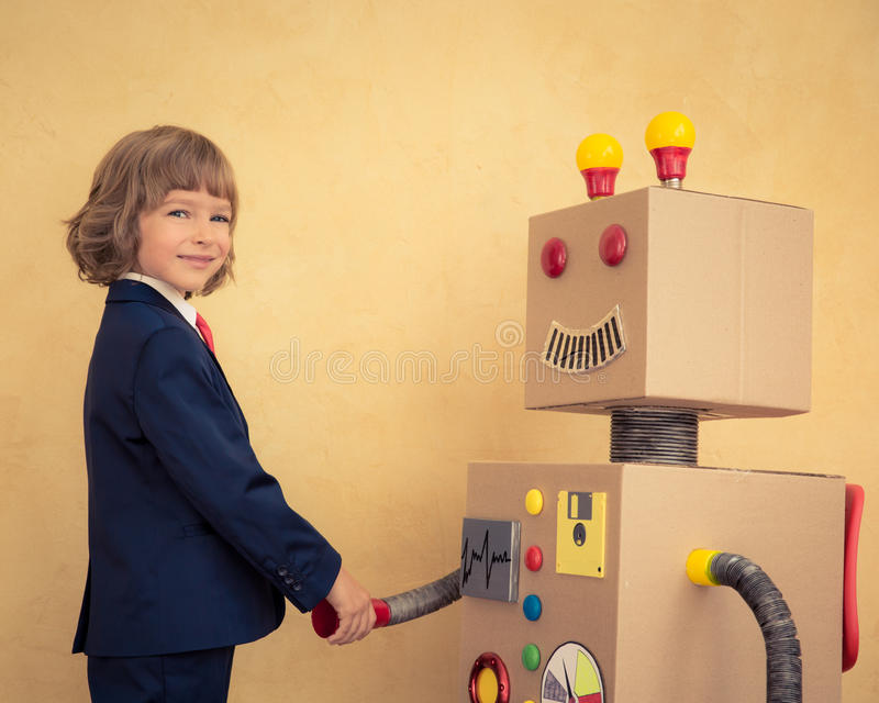 Young businessman with robot. Portrait of young businessman with toy robot in modern loft office. Success, creative and innovation technology concept. Copy space stock photo