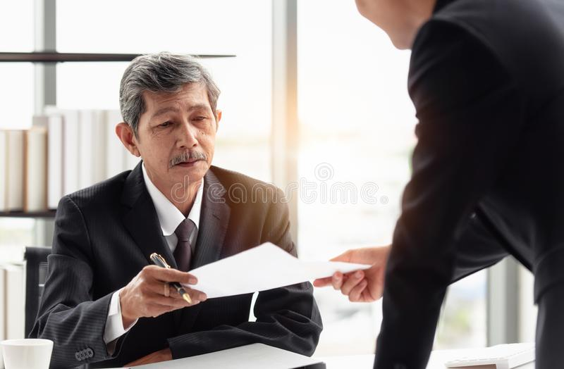 The businessman sending report to boss on hand. The young businessman sending the report to his boss on hand in the office room royalty free stock photography