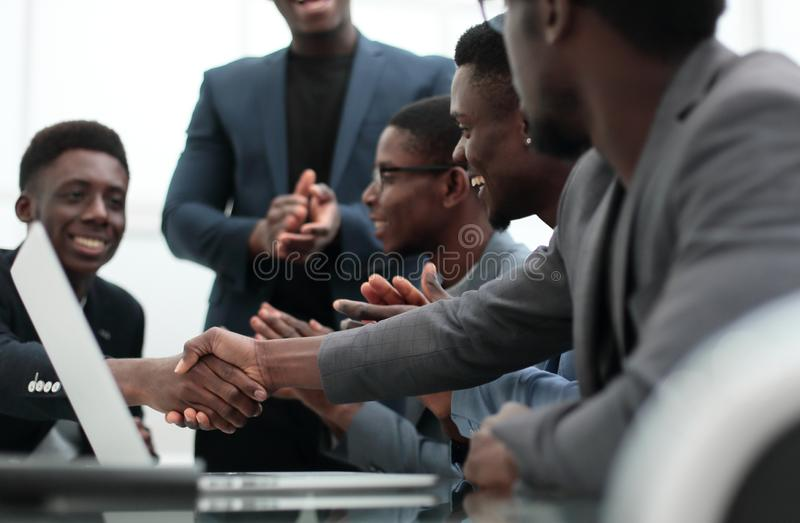 Young businessman shaking hands with his business partner royalty free stock photography