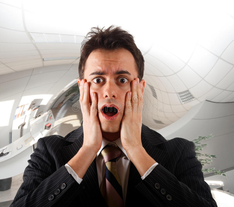 Young businessman shocked stock photography