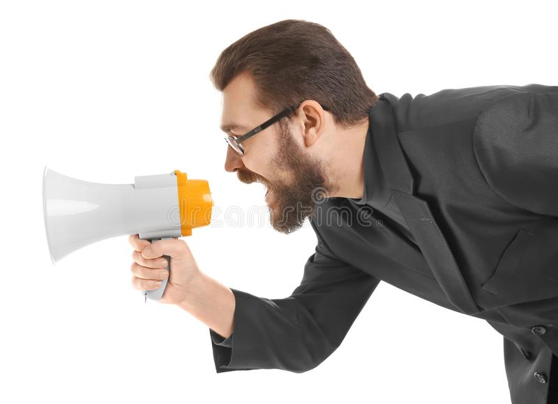 Young businessman shouting into megaphone royalty free stock images