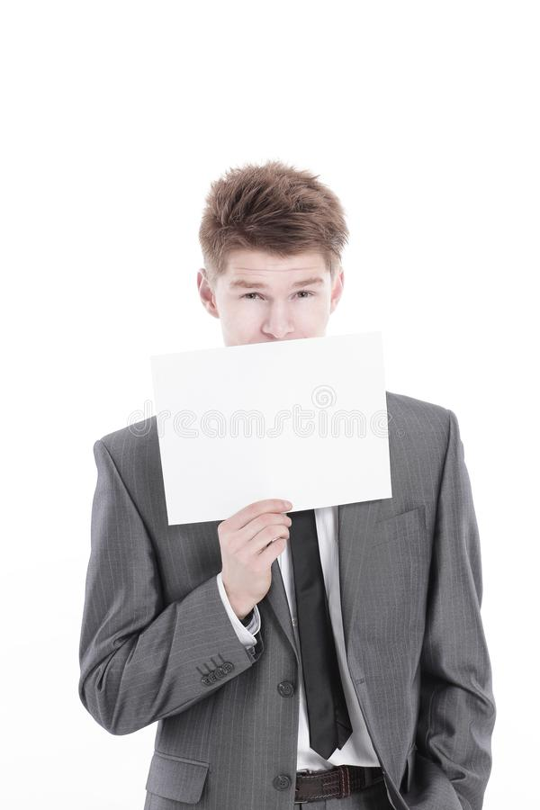 Young businessman showing a blank sheet.isolated on a white. Background royalty free stock photography