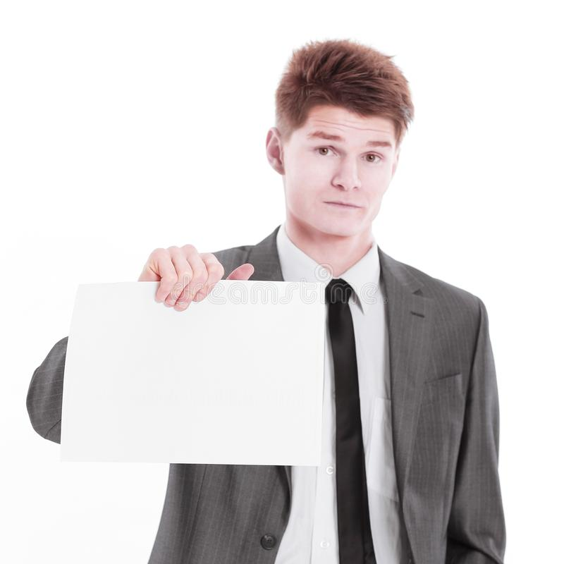 Young businessman showing a blank sheet.isolated on a white. Background stock photo