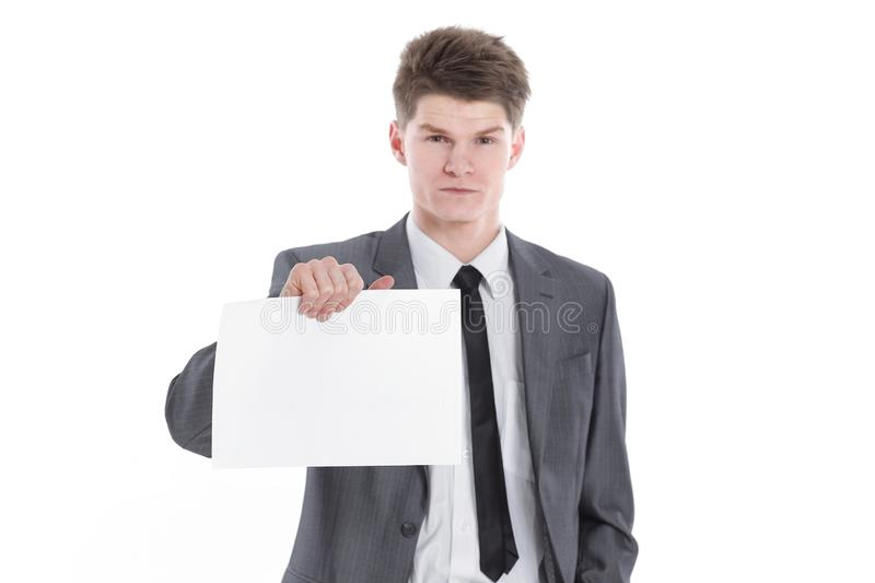 Young businessman showing a blank sheet.isolated on a white. Background royalty free stock photo