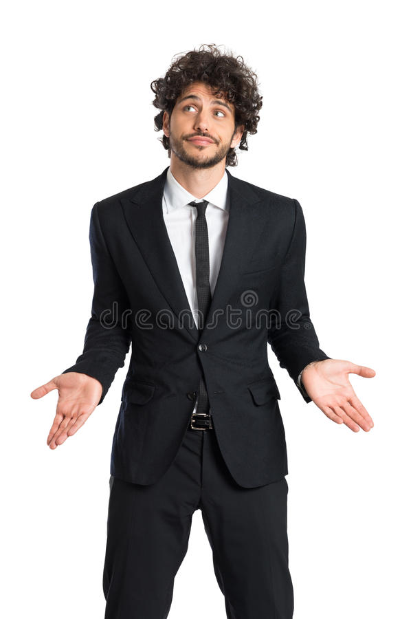 Young Businessman Shrugging. Portrait Of Uncertain Man Looking Up Isolated On White Background stock photography