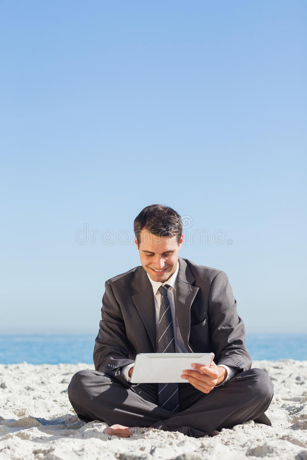 Download Young Businessman Siiting Using His Tablet Computer Stock Image - Image: 32516451