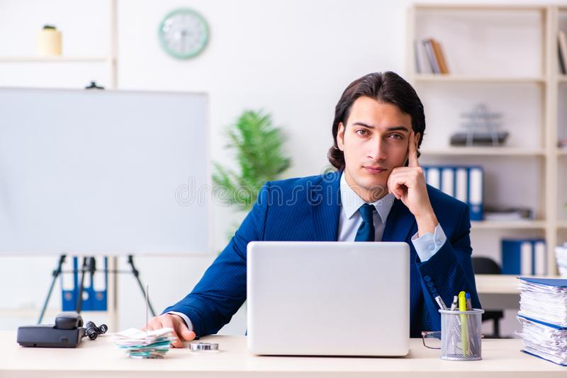 Young businessman sitting and working in the office stock photography
