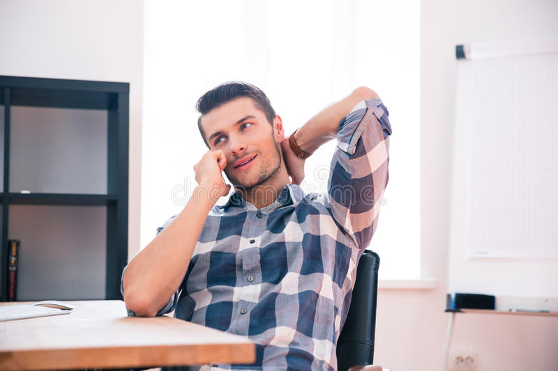Young businessman speaking on the phone in office stock photos
