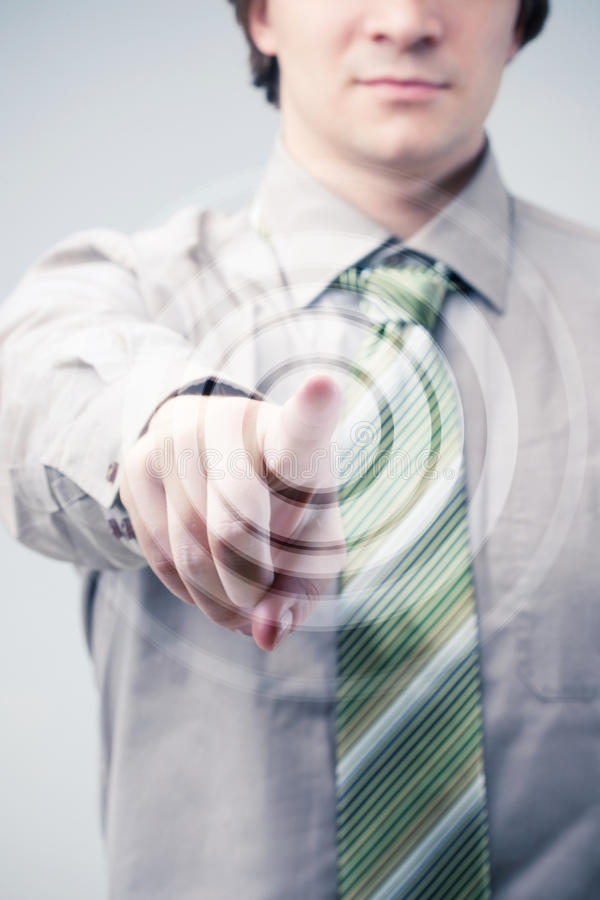 Young businessman specifies in you a finger royalty free stock photography