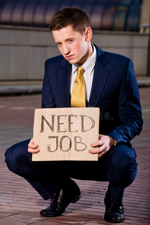 Download Young Businessman Squatting With Sign Need Job Stock Photo - Image: 6884198