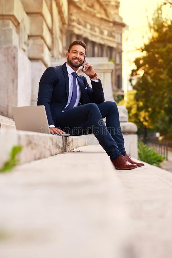 Young businessman on the stairs royalty free stock images