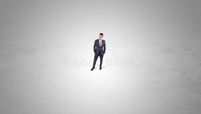 Businessman standing in the middle of an empty space stock photo