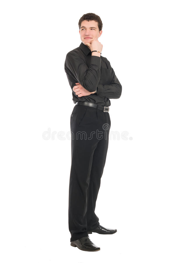 Young businessman standing in full length looking away stock image