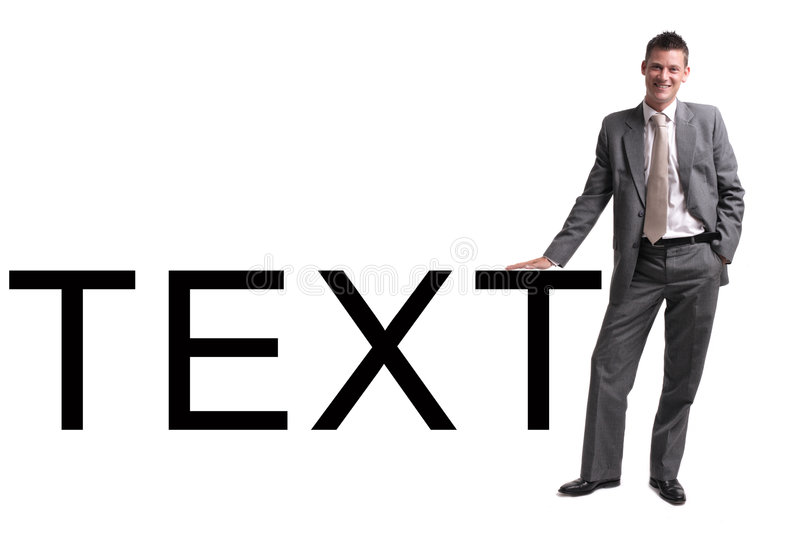 Young businessman standing leaning against text royalty free stock photography