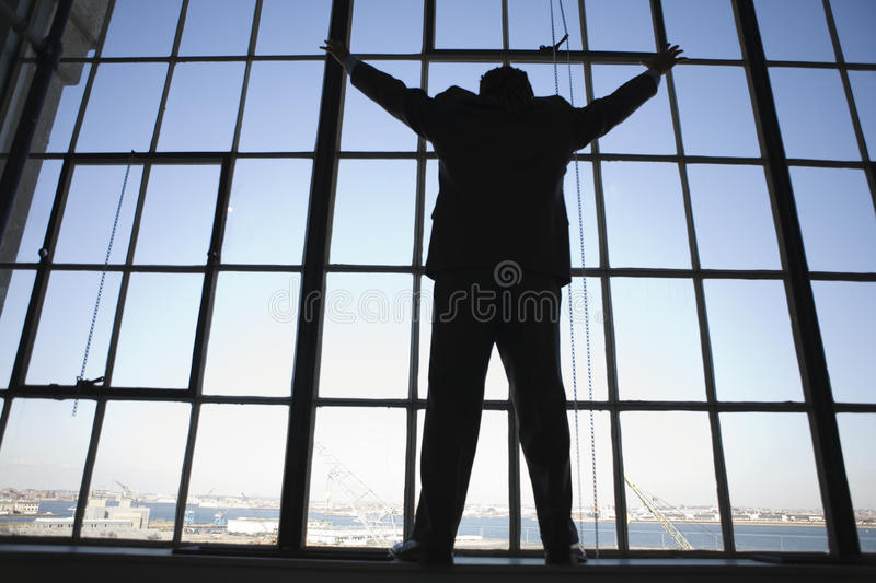 Download A Young Businessman Standing At And Looking Out Ta Stock Photo - Image: 9885626