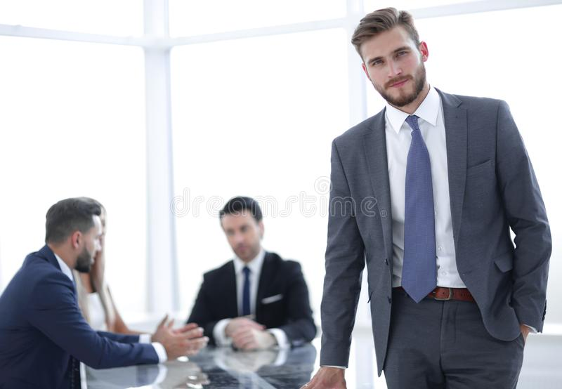 Young businessman standing near the office Desk royalty free stock photography
