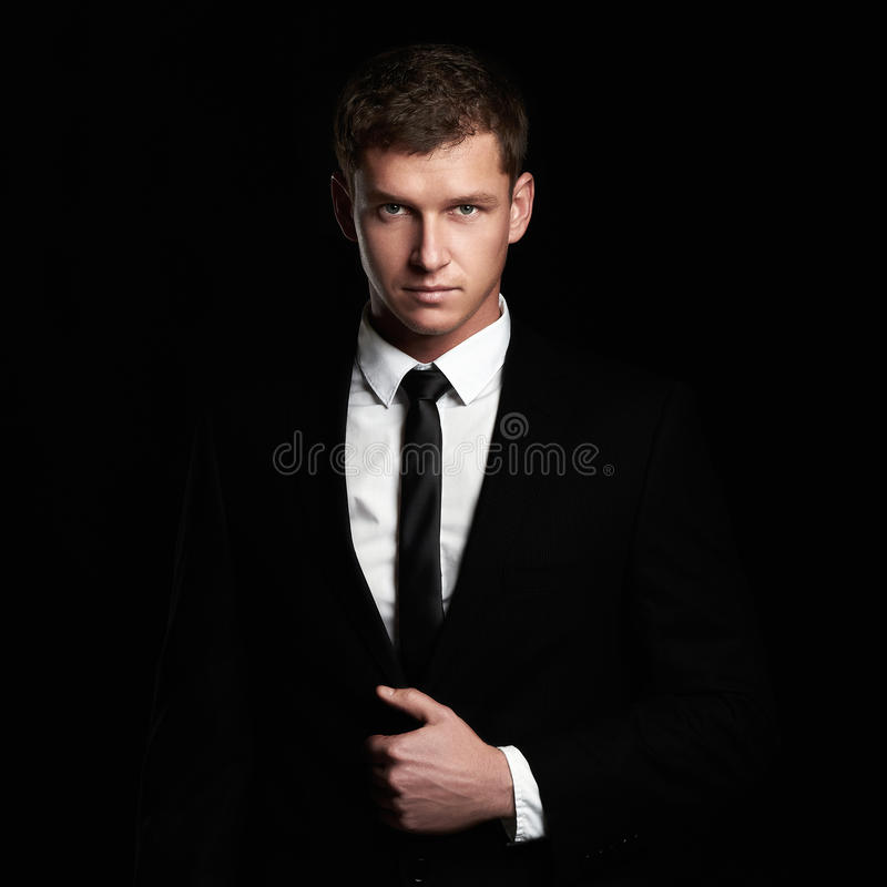 Free Young Businessman Standing On Black Background. Handsome Man In Suit And Tie Stock Photography - 71560442