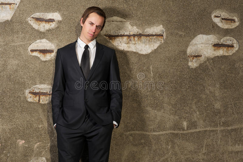 Young businessman standing outdoors in trendy suit royalty free stock photography