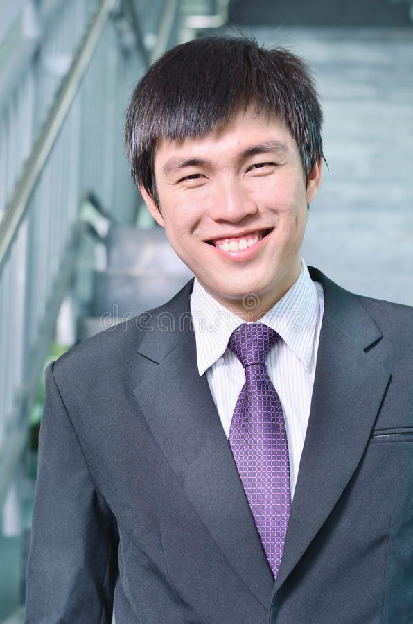 Young businessman in success face. Close up of young businessman in success face royalty free stock photo